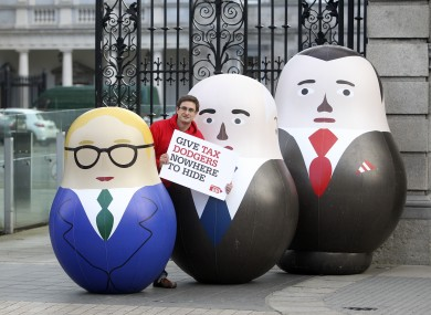 Pictured Christian Aid Campaign Officer David Thomas is pictured outside Leinster House yesterday with three blow up Russian style dolls that represent owners of Phantom companies, which Christian Aid say companies use to avoid paying tax and to launder money.