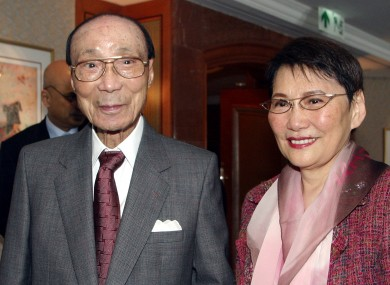 Hong Kong movie producer Run Run Shaw poses with his wife Mona Fong in Hong Kong.