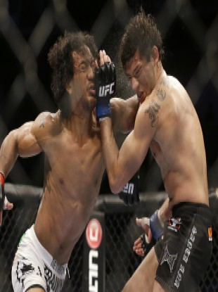 Benson Henderson, left, punches Gilbert Melendez in April.