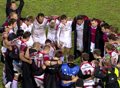 The Ulster players huddle around captain Johann Muller.