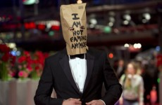 Shia LaBeouf arrives on red carpet with a paper bag over his head