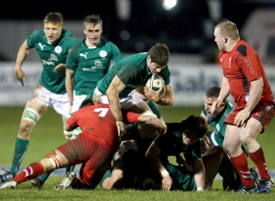 Ireland's Jack O'Donoghue tackled by James Benjamin of Wales.