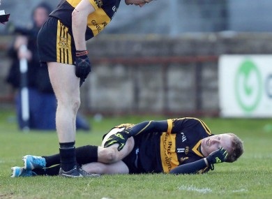 Kieran O'Leary of Crokes checks on the injured Colm Cooper yesterday.