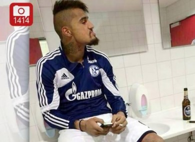 Boateng pictured smoking with a bottle of beer beside him.