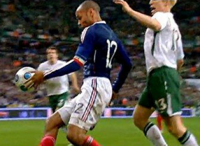 Thierry Henry keeps the ball in play against Ireland in 2009.