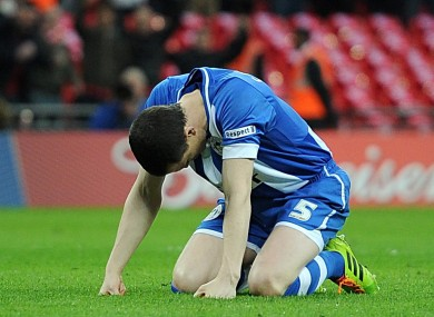 Wigan Athletic's Gary Caldwell looks dejected after missing his teams first penalty.