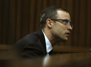 Oscar Pistorius sits in the dock at a court in Pretoria, South Africa