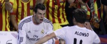 Gareth Bale, left, celebrates with Xabi Alonso after scoring his team's second goal during the final of the Copa del Rey.