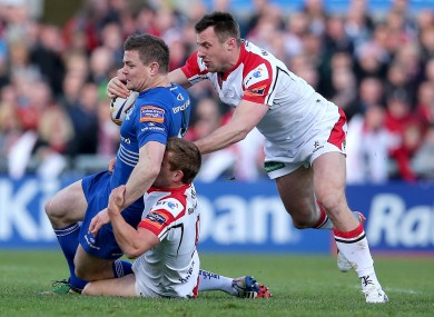 Leinster's Brian O'Driscoll is tackled by Tommy Bowe and Paul Marshall of Ulster.