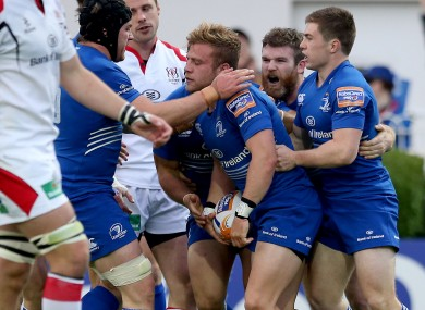Leinster players swarm to Madigan after his semi final try against Ulster.