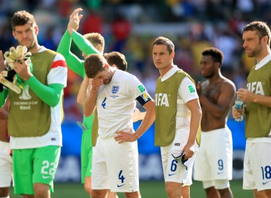 England captain Steven Gerrard and the England players at the final whistle.